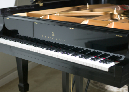 "Steinway B Ebony Satin 6'10"" - This piano was purchased new in 2014 from the Steinway Piano Factory, and has less than 100 hours playing time, which means it's essentially a new piano."